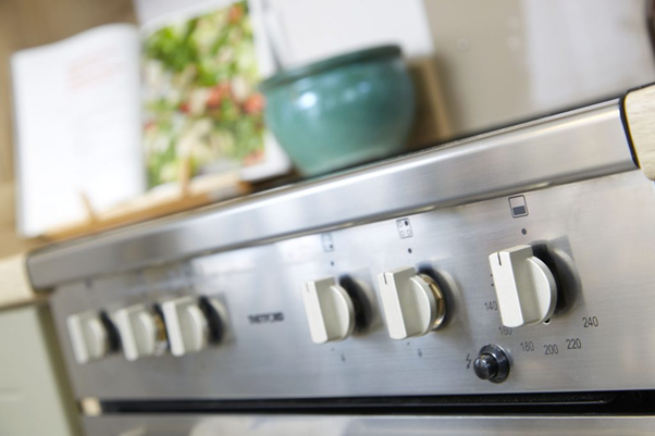 The dials of a hob in the kitchen area of a Brickyard Lakes holiday home on their static caravan site